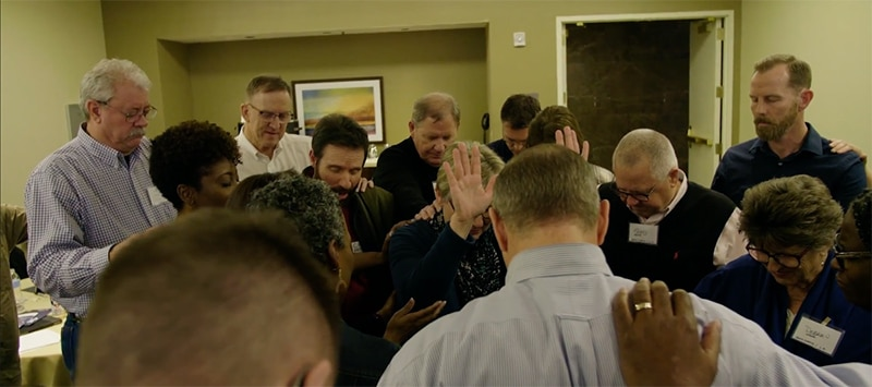 group of people in prayer